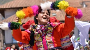 local peruvian woman dancing at the mainsquare of Cusco